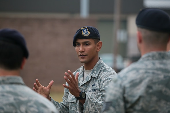 A picture of U.S. Air Force Staff Sgt. Mark Torres from the 610th Security Forces Squadron instructing Air National Guard, U.S. Coast Guard, and local law enforcement officers on active shooter tactics.
