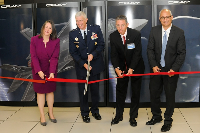 From left: Ms. Christine Cuicchi, Associate Director for DoD High Performance Computing Centers, AFRL commander Maj. Gen. Thomas Masiello, Mr. Jeff Graham, Chief of Air Force Research Laboratory's DoD Supercomputing Resource Center, and Mr. Peter Ungaro, CEO Cray Inc. cut the ribbon in a ceremony unveiling the new Lightning supercomputer. (U.S. Air Force photo by Wesley Farnsworth)