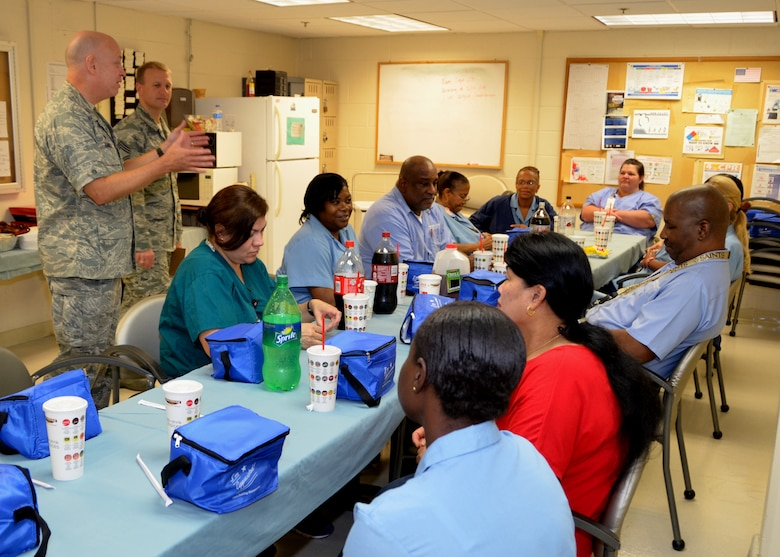 "Col. (Dr.) Tom Harrell, 81st Medical Group commander, and Chief Master Sgt. Mike Wood, 81st MDG superintendent, stop by the medical center Housekeeping Department Sept. 17 as the staff observed ""National Housekeeper Appreciation Week"" with a luncheon.  Harrell and Wood thanked the department staff for their invaluable service to the medical center.  Col. Kathryn Weiss, 81st MDG deputy commander, also added words of appreciation. (U.S. Air Force photo by Steve Pivnick)"