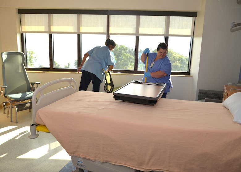 "Keesler Medical Center housekeepers Judy Dickerson, left, and Theresa Migues prepare a room on the Surgical Inpatient Unit for a new patient Sept. 18.  The medical center housekeepers joined their counterparts nationwide Sept.14-20 to observe ""National Housekeeper Appreciation Week."" (U.S. Air Force photo by Steve Pivnick)"