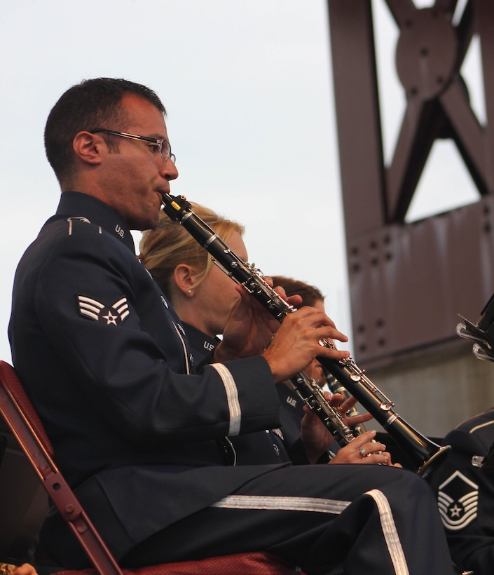 U.S. Air Force Senior Airman Jose E. Silva, instrumentalist with the 566th Air Force Band, performs during the Air National Guard Band of the Midwest's annual training at the Bayfront Festival Park, Duluth, Minn., July 4, 2014. They performed jazz, rock and concert music for audiences in Illinois and Wisconsin as part of their community relations tour before a grand finale in Minnesota July 4. The annual concert series was the result of a year's worth of training and practice, one that the band used to celebrate patriotism with communities across the Midwest. (Courtesy photo/Released)