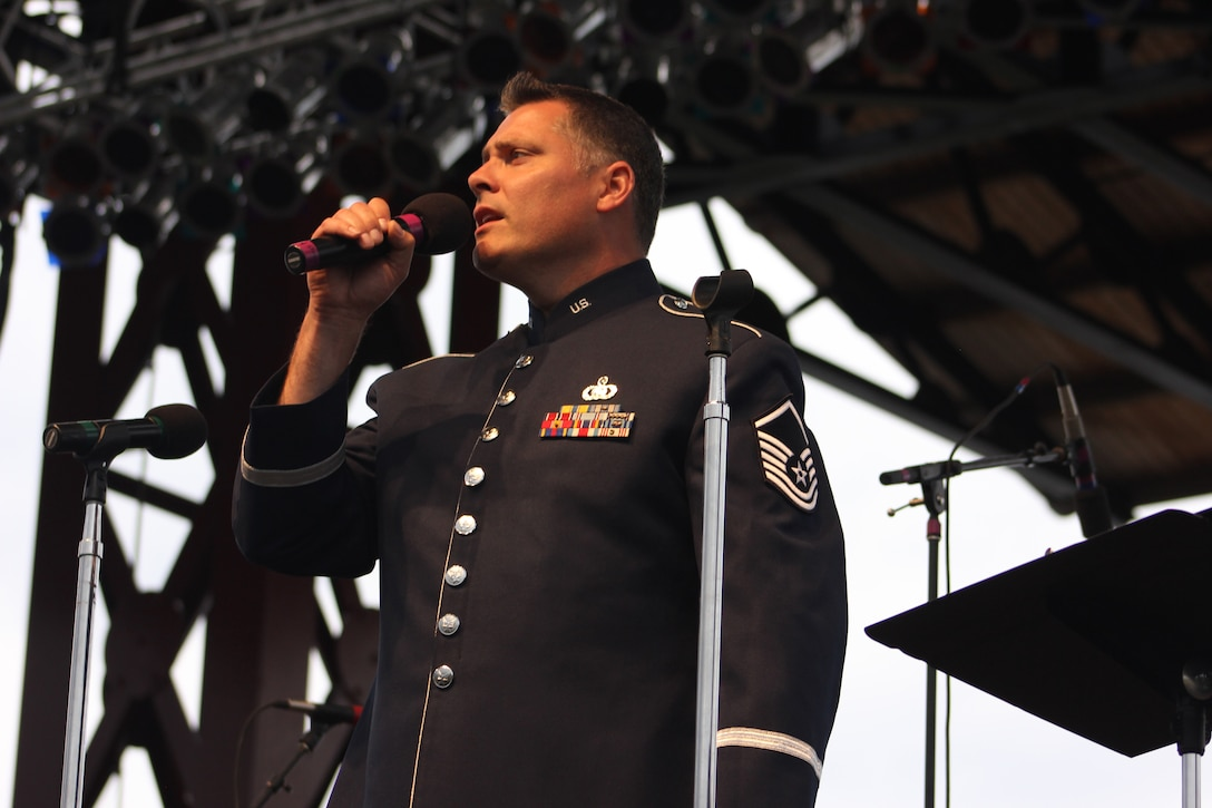 U.S. Air Force Master Sgt. Douglas A. Mattsey, instrumentalist with the 566th Air Force Band, performs during the Air National Guard Band of the Midwest's annual training at the Bayfront Festival Park, Duluth, Minn., July 4, 2014. They performed jazz, rock and concert music for audiences in Illinois and Wisconsin as part of their community relations tour before a grand finale in Minnesota July 4. The annual concert series was the result of a year's worth of training and practice, one that the band used to celebrate patriotism with communities across the Midwest. (Courtesy photo/Released)