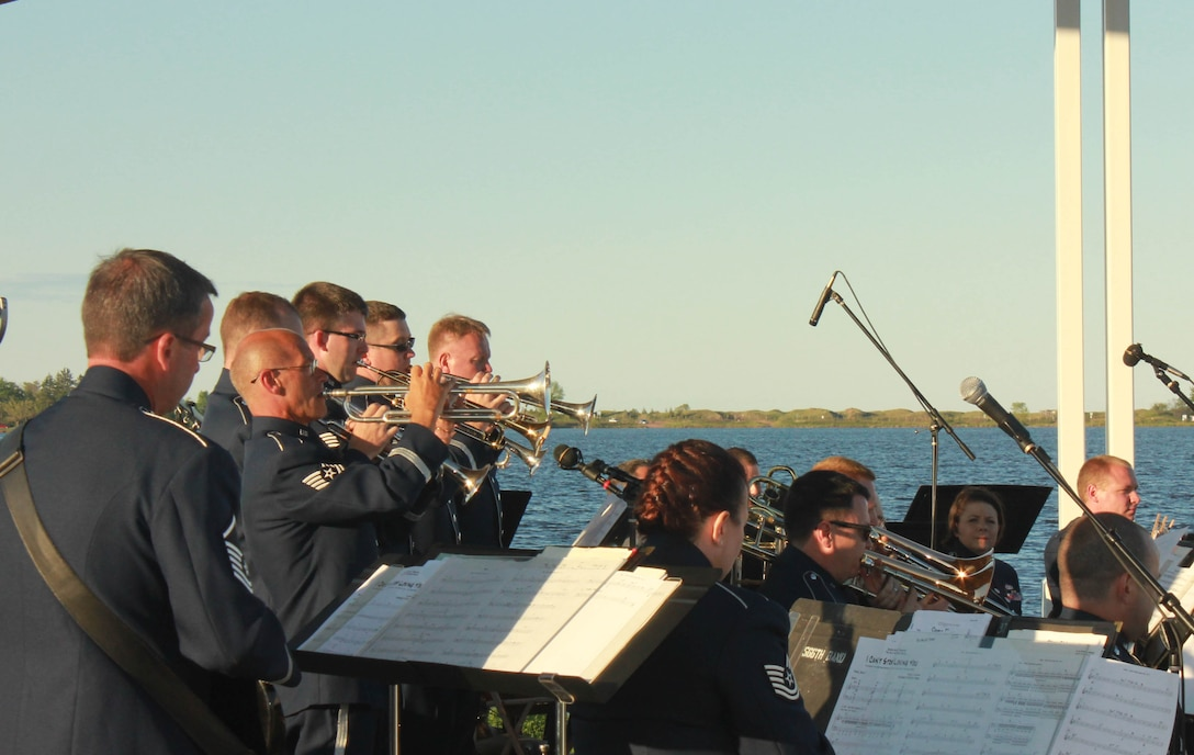 Instrumentalists with the Air National Guard Band of the Midwest perform for audiences during annual training at Barker's Island Festival Park, Superior, Wis., July 3, 2014. They performed jazz, rock and concert music for audiences in Illinois and Wisconsin as part of their community relations tour before a grand finale in Minnesota July 4. The annual concert series was the result of a year's worth of training and practice, one that the band used to celebrate patriotism with communities across the Midwest. (Courtesy photo/Released)