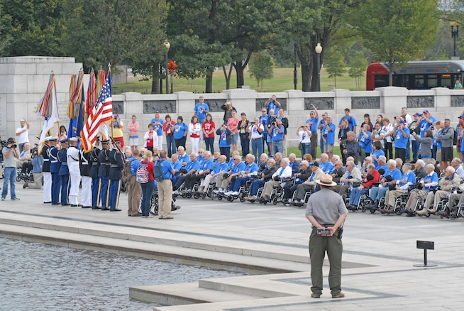 A military color guard sang the National Anthem and played Taps for Utah Honor Flight veterans upon their arrival at the World War II Memorial in Washington, D.C., Sept. 19, 2014. The veterans were part of a group of 66 that were there to see their memorial, many for the first time.(U.S. Air Force photo by Senior Master Sgt. Gary J. Rihn/Released)