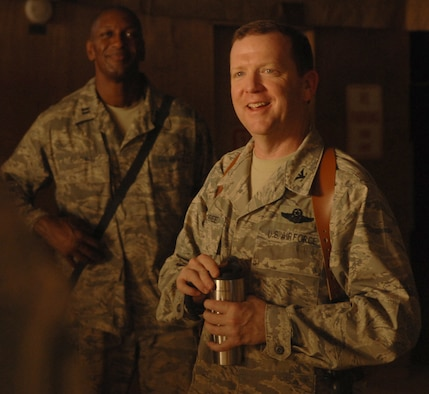 """Brig. Gen. Richard Scobee (a colonel at the time) addresses Airmen assigned to the 506th Air Expeditionary Group, Kirkuk Regional Air Base, Iraq, in 2008. """"I am so impressed and so proud of our Air Force and how much we as Airmen contribute to what's going on over here,"""" Scobee said of the time he spent as commander of the 506th AEG. Scobee is scheduled to become the commander of 10th Air Force on Oct. 18. (Senior Airman Randi Flaugh)"""