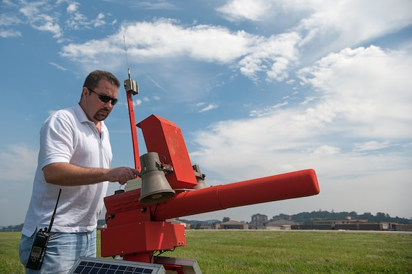 Michael Rosen, 51st Fighter Wing Bird Aircraft Strike Hazard program superintendent, manually operates a bird cannon at Osan Air Base, Republic of Korea, Sept. 9, 2014. There are 30 bird cannons strategically placed all over the airfield to scare birds away. (U.S. Air Force photo by Senior Airman Matthew Lancaster)