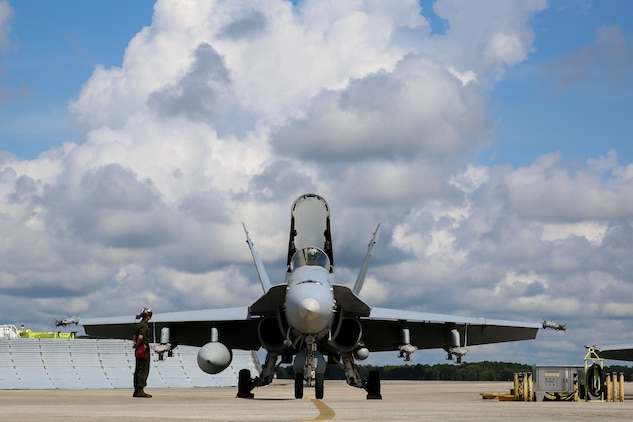 Marines with Marine Fighter Attack Squadron 251 prepare jets to take off for a group sail exercise, Sept. 18. The exercise promotoes the unity and synergy of Carrier Strike Group 12, which has not worked together since 2012, in preparation of an upcoming deployment.