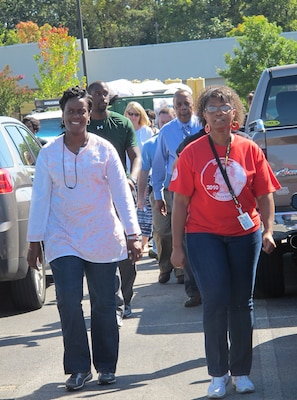 Carla McNeal, left, leads Huntsville Center employees in a stress relief walk Sept. 24.