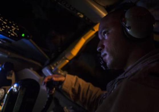 1st Lt. Marcel Trott, a KC-135 Stratotanker pilot with the 340th Expeditionary Air Refueling Squadron, takes off from a base in the U.S. Central Command Area of Responsibility on a mission supporting airstrikes in Syria, Sept. 23, 2014. Multiple KC-135 Stratotankers were part of a large coalition strike package that was the first to strike ISIL targets in Syria. (U.S. Air Force photo by Senior Airman Matthew Bruch)