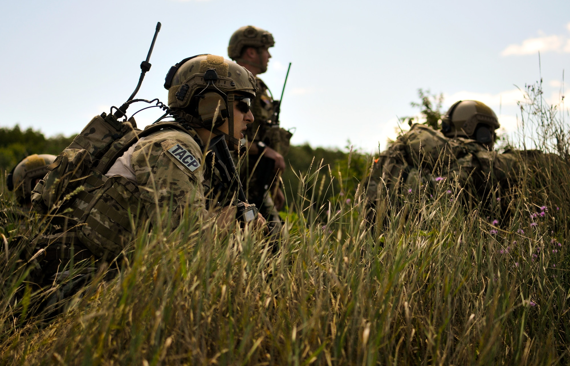Tactical air control party specialists with the 169th Air Support Operations Squadron survey an enemy-controlled landing zone before calling in close-air support  Aug. 14, 2014, at Operation Northern Strike in Grayling Air Gunnery Range, Grayling, Mich. Northern Strike was a 3-week exercise that demonstrated the combined power of joint and multinational air and ground forces. TACPs with the Air National Guard's 169th ASOS from Peoria, Ill., and more than 5,000 other armed forces members from 12 states and two coalition nations participated in the combat training. (U.S. Air National Guard photo/Staff Sgt. Lealan Buehrer)
