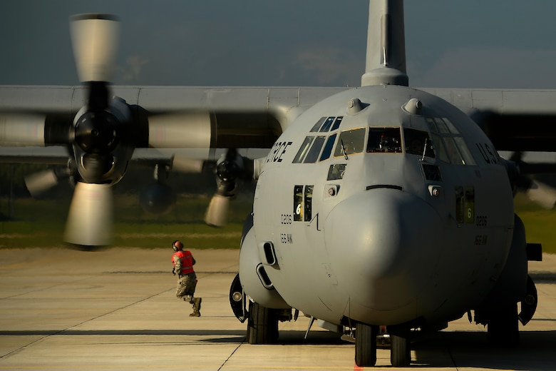 A C-130H Hercules aircraft assigned to the 142nd Airlift Squadron, Delaware Air National Guard is on the flight line at Lielvarde Air Base, Latvia. U.S. Soldiers assigned to the 173rd Airborne Brigade Combat Team prepare to depart from the base Sept. 7, 2014, during exercise Steadfast Javelin II. Steadfast Javelin II is a NATO-led exercise designed to prepare U.S., NATO and international partner forces for unified land operations. (U.S. Air Force photo by Staff Sgt. Tim Chacon)