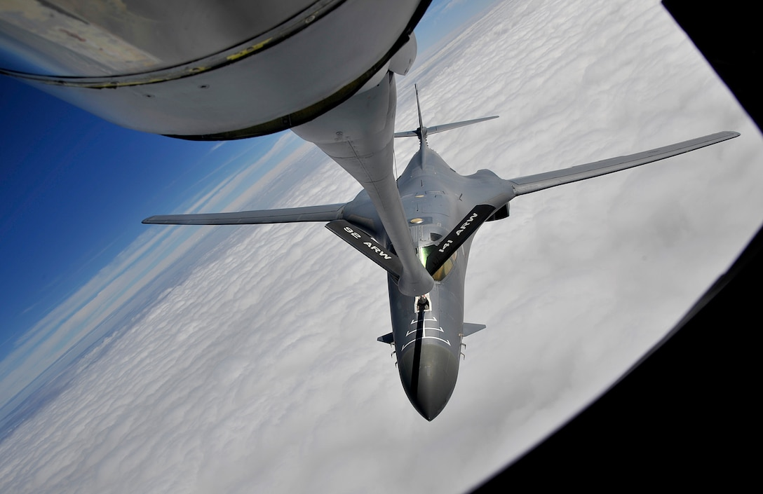 A KC-135 Stratotanker from Fairchild Air Force Base refuels a B-1B Lancer during a training exercise Sept. 23, 2014, over South Dakota. For more than 50 years the KC-135 has provided the core aerial refueling capability for the Air Force. The aircraft can travel up to 1,500 miles with 150,000 pounds of transfer fuel, which enables the Air Force to project rapid, flexible military power. The B-1B is assigned to Ellsworth Air Force Base, South Dakota. (U.S. Air Force photo by Senior Airman Mary O'Dell)