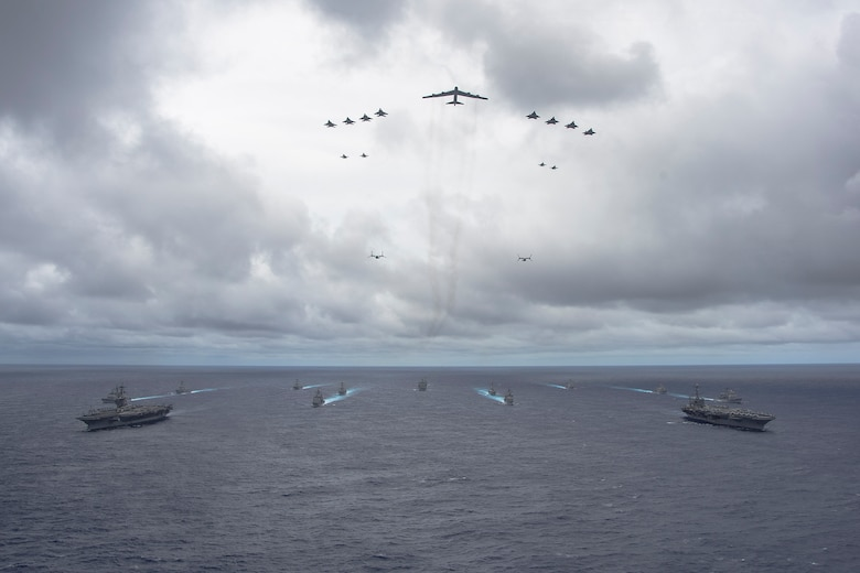 Ships from the George Washington and Carl Vinson Carrier Strike Groups and aircraft from the Air Force and Marine Corps operate in formation at the conclusion of Valiant Shield 2014. Valiant Shield is a U.S.-only exercise integrating Navy, Air Force, Army, and Marine Corps assets, offering real-world joint operational experience to develop capabilities that provide a full range of options to defend U.S. interests and those of its allies and partners. (U.S. Navy photo by Mass Communication Specialist 1st Class Trevor Welsh)