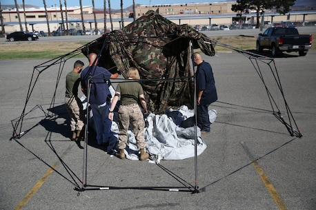 Marines and civilian contractors put together an Arctic shelter Aug. 29, 2014, aboard Camp Pendleton, California. The system is an ultra-lightweight, rapidly deployable shelter that offers military forces the necessary infrastructure to operate in austere cold-weather locations. The system is being used for training exercises in Bridgeport, California, and is slated to be integrated into exercises early next year. (U.S. Marine Corps photo by Sgt. Laura Gauna/released)