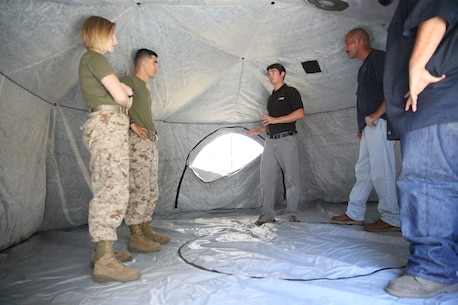 Marines and civilian contractors stand inside an Arctic shelter Aug. 29, 2014, aboard Camp Pendleton, California. The system is an ultra-lightweight, rapidly deployable shelter that offers military forces the necessary infrastructure to operate in austere cold-weather locations. The system is being used for training exercises in Bridgeport, California, and is slated to be integrated into exercises early next year. (U.S. Marine Corps photo by Sgt. Laura Gauna/released)