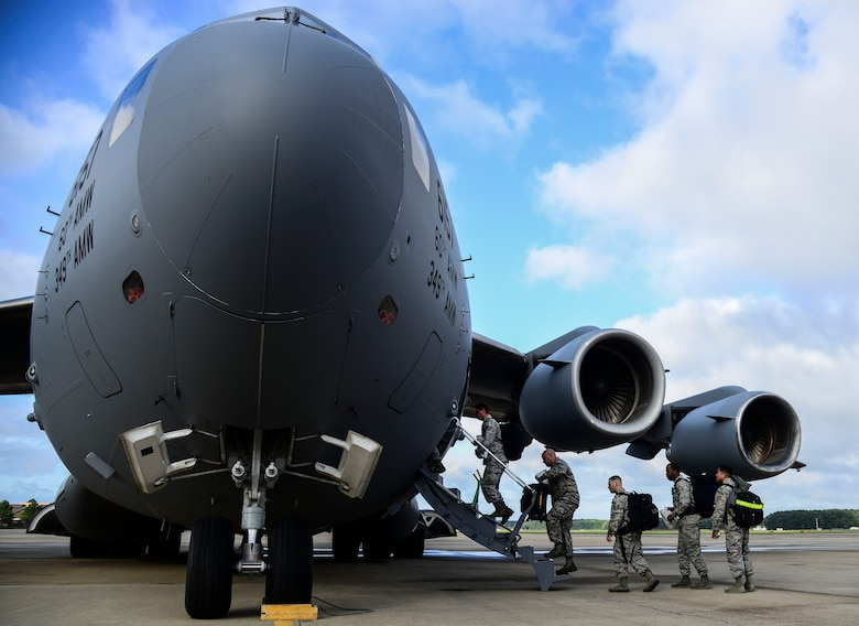 U.S. Air Force Airmen assigned to the 633rd Medical Group load onto a C-17 Globemaster at Langley Air Force Base, Va., Sept. 26, 2014. The 633 MDG packaged and delivered a modular medical treatment center, as part of a government-wide effort to support humanitarian relief operations in Ebola-stricken African nations. Langley Airmen will not be involved in treatment of patients exposed to the Ebola virus. (U.S. Air Force photo by Senior Airman Kayla Newman/Released)