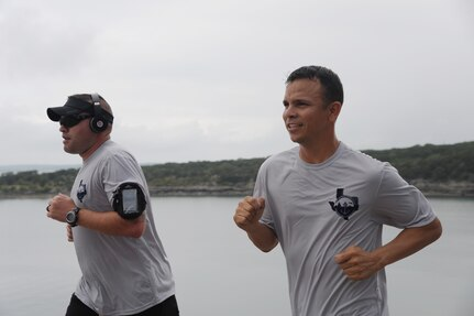 Rambler 120 participants run 6 miles following a 22-mile bike ride Sept. 20 at Canyon lake, Texas. After the run, the teams completed a 2-mile boat race. (U.S. Air Force photo by Senior Airman Krystal Jeffers/Released)