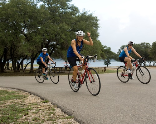 Relay teams stay motivated and power through the 22-mile biking portion of the Rambler 120 Adventure Race at Joint Base San Antonio Recreation Part Sept. 20, 2014. The rigorous route, throughout Canyon Lake, tests participant's endurance and strength. (U.S. Air Force photo by Airman Justine K. Rho/released)