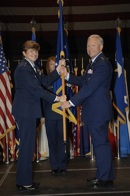 Gen. Janet Wolfenbarger, Air Force Materiel Command commander, passes the Air Force Life Cycle Management Center flag to Lt. Gen. John F. Thompson in a ceremony at the National Museum of the United States Air Force Sept. 26.  Thompson will officially take command of AFLCMC Oct. 2.  (Air Force photo by Al Bright)