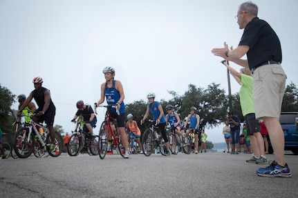 Brig. Gen. Bob LaBrutta 502 Air Base Wing and Joint Base San Antonio Commander cheers on participants at the start of the Rambler 120 Race, which includes running, biking, rafting and a mystery event, was held at Joint Base San Antonio Recreation Park at Canyon Lake Sept. 20.  Twenty-nine teams competed in the 22-mile bike course, 6-mile run 2-mile rafting event and the frisbee golf challenge. (U.S. Air Force photo by Joshua Rodriguez) (released)