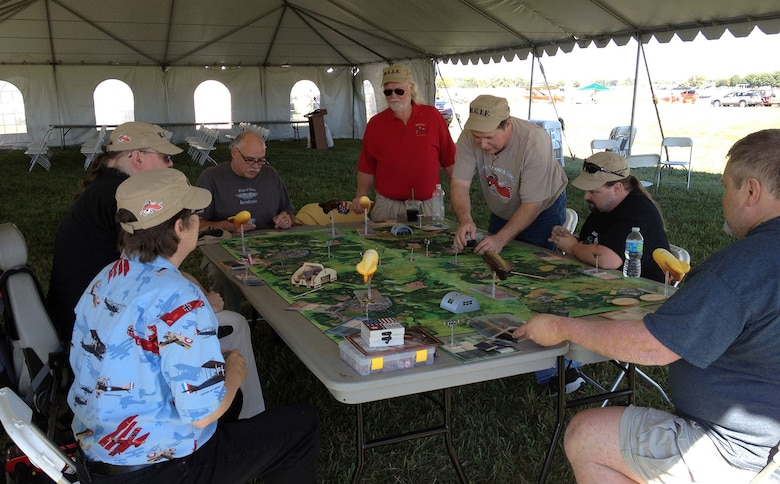 "DAYTON, Ohio -- Visitors can get a better understanding of the war in Europe with Buckeye Gamers in Flight's giant WWI board game ""Wings of Glory,"" along with trying out aircraft computer simulators to experience ""flying"" a WWI aircraft, during the Ninth WWI Dawn Patrol Rendezvous on Sept. 27-28, 2014. (U.S. Air Force photo)"