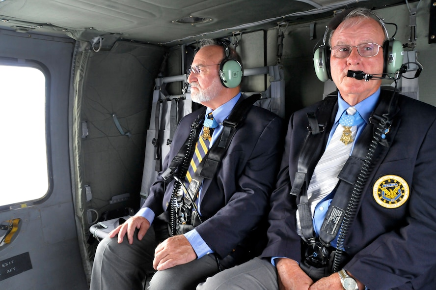 Congressional Medal of Honor recipients 1Lt Brian Thacker and Command Sergeant Maj. Robert Patterson take in the view of East Tennessee from an Army National Guard Blackhawk helicopter on their way to speak to students at Greenville High School while in Knoxville, Tennessee for the 2014 Medal of Honor Convention. (U.S. Air National Guard photo by Master Sgt. Kendra M. Owenby, 134 ARW Public Affairs)