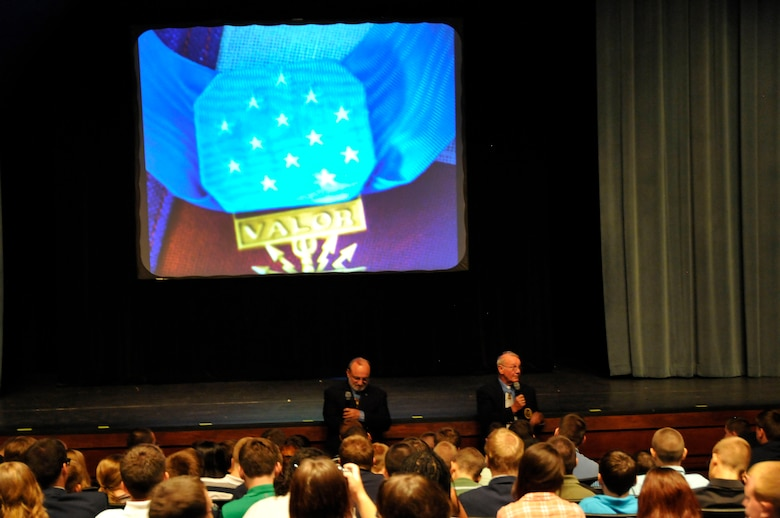 Congressional Medal of Honor recipients 1Lt Brian Thacker and Command Sergeant Maj. Robert Patterson speak to students at Greenville High School while in Knoxville, Tennessee for the 2014 Medal of Honor Convention. (U.S. Air National Guard photo by Master Sgt. Kendra M. Owenby, 134 ARW Public Affairs)