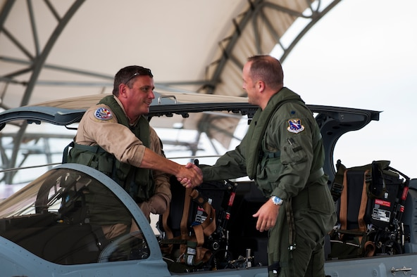 Chris Carlson, left, Sierra Nevada Corporation senior pilot, shakes hands with U.S. Air Force Lt. Col. Jeffrey Hogan, Afghan A-29 Light Air Support training unit commander, after landing an A-29 Super Tucano for its first arrival Sept. 26, 2014, at Moody Air Force Base, Ga. Moody was selected for the A-29 LAS training mission to train a total of 30 Afghan pilots and 90 Afghan maintainers over the next four years. (U.S. Air Force photo by Airman 1st Class Dillian Bamman/Released)