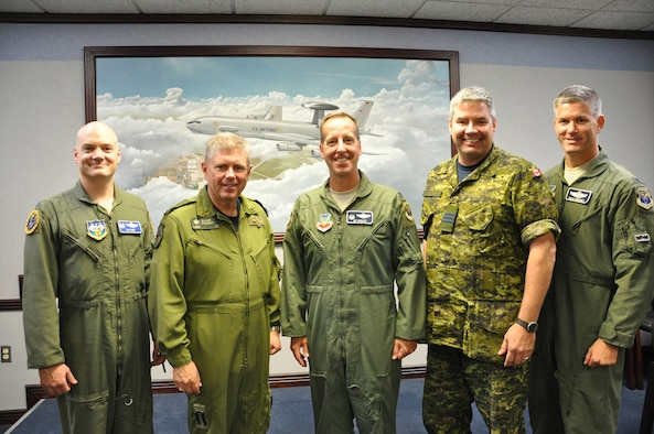"North American Aerospace Defense Deputy Commander Lt. Gen. Alain Parent, second from left, and his executive officer and special advisor, Col. John ""Tim"" Budd, left, take time out of their busy schedule Tuesday to pose for a photograph with 552nd Air Control Wing Commander Col. Jay R. Bickley, 552nd ACW Canadian Detachment Commander Lt. Col. Peter Dozois and Col. Brian Humphrey, vice commander for the 552nd ACW. During General Parent's whirlwind visit to the Tinker Air Force Base, which lasted only about four hours, the deputy NORAD commander participated in an office call with Colonel Bickley, received a mission briefing in the Command Post and conducted an ""All-Hands Call"" with members of the Canadian Detachment in Bldg. 230. (Air Force photo by Darren D. Heusel)"
