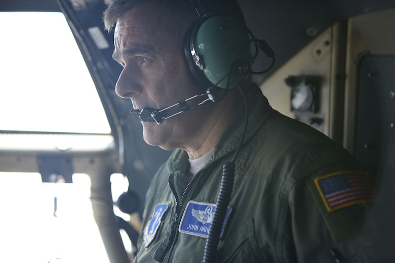 """107th Airlift Wing Commander, Col. John J. Higgins, completes his """"fini flight,"""" his last flight as a navigator on September 25, 2014. The aircrew flew its last C-130 mission at Niagara Falls Reserve Station before converting to MQ-9 operations. (U.S. Air National Guard Photo/Staff Sgt. Ryan Campbell)"""