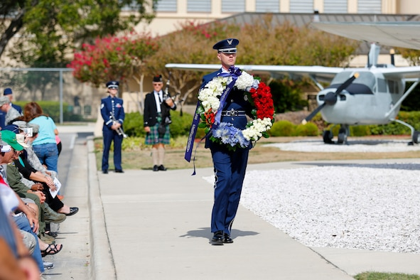 Staff Sgt. Chris Strunk presents a memorial wreath during the annual Anniversary Week Remembrance Ceremony Sept. 26, 2014, at the Air Force Intelligence, Surveillance and Reconnaissance Agency headquarters on Joint Base San Antonio-Lackland. (U.S. Air Force photo/Capt. Andrew Caulk)