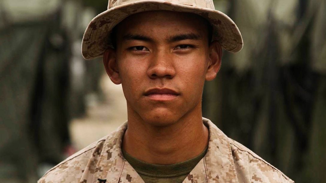 Lance Cpl. Edward Manibusan, Jr., from Koblerville, Saipan, stands outside of his tent Sept. 26 during Exercise Forager Fury III. He was raised in Saipan, located near Tinian, and joined the Marine Corps shortly after graduating high school. Manibusan is a field wireman with Marine Wing Support Squadron 171, Marine Aircraft Group 12, 1st Marine Aircraft Wing, III Marine Expeditionary Force. (U.S. Marine Corps photo by Lance Cpl. Tyler Ngiraswei/ Released)