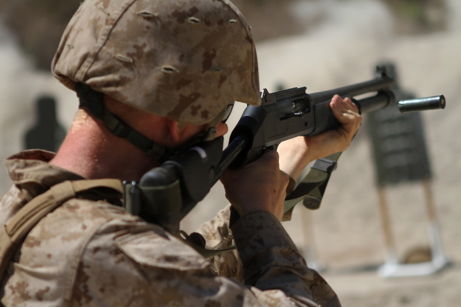 Lance Corporal Colin Stegal, an ammo technician with Ammo Company, 1st Supply Battalion, fires a M1014 shotgun aboard Marine Corps Base Camp Pendleton, Calif., Sept. 15, 2014. The range required Marines to demonstrate proficiency with the M1014 shotgun. The live-fire ranges were part of an annual training package to keep the Marines confident and proficient with each weapon system.