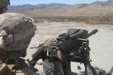 Marines with Ammo Company, 1st Supply Battalion, operate an Mk19 automatic grenade launcher aboard Marine Corps Base Camp Pendleton, Calif., Sept. 17, 2014. The Marines were required to engage simulated targets while conducting the basic machine gun course. The live-fire ranges were part of an annual training package to keep the Marines confident and proficient with each weapon system.