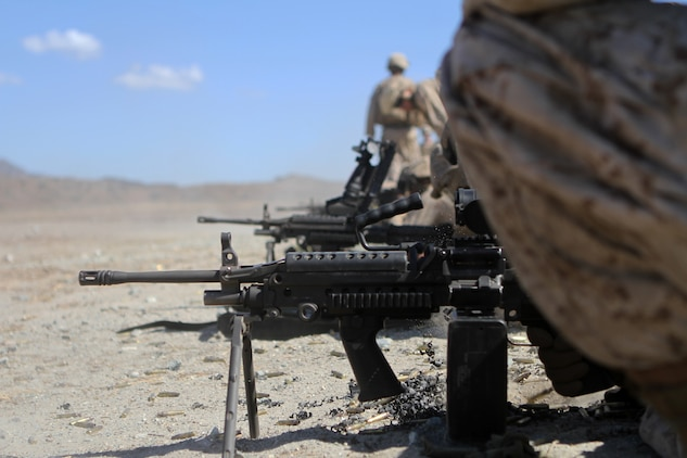 Ammo technicians with Ammo Co., 1st Supply Battalion conduct a basic machine gun range aboard Marine Corps Base Camp Pendleton, Calif., Sept. 17, 2014. The range required the Marines to demonstrate proficiency with M249 SAWs, M240Bs, M2s and Mk19s. The live-fire ranges were part of an annual training package to keep the Marines confident and proficient with each weapon system.