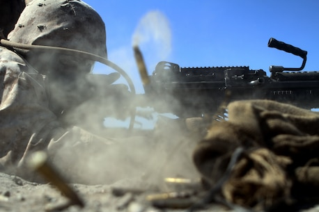 Lance Corporal Dashaun Dancy, an ammo technician with Ammo Company, 1st Supply Battalion fires an M249 SAW aboard Marine Corps Base Camp Pendleton, Calif., Sept. 17, 2014. The Marines were required to engage simulated targets with weapons ranging from M1014 Benelli shotguns to AT-4 rocket launchers. The live-fire ranges were part of an annual training package to keep the Marines confident and proficient with each weapon system.