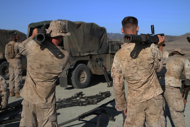 Marines with Ammo Company, 1st Supply Battalion, prepare to fire M2 .50-caliber machine guns aboard Marine Corps Base Camp Pendleton, Calif., Sept. 17, 2014. The range required Marines to demonstrate proficiency with M249 SAWs, M240Bs, M2s and Mk19s. The live-fire ranges were part of an annual training package to keep the Marines confident and proficient with each weapon system.