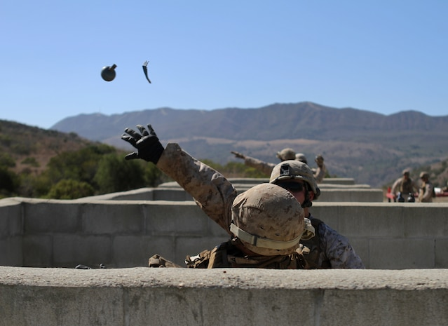 Ammo technicians with Ammo Company, 1st Supply Battalion, conduct practical application procedures before moving on to the live grenade range aboard Marine Corps Base Camp Pendleton, Sept. 16, 2014. It was part of the annual training to refresh the Marine's ability to function with a live grenade. The live-fire ranges were part of an annual training package to keep the Marines confident and proficient with each weapon system.