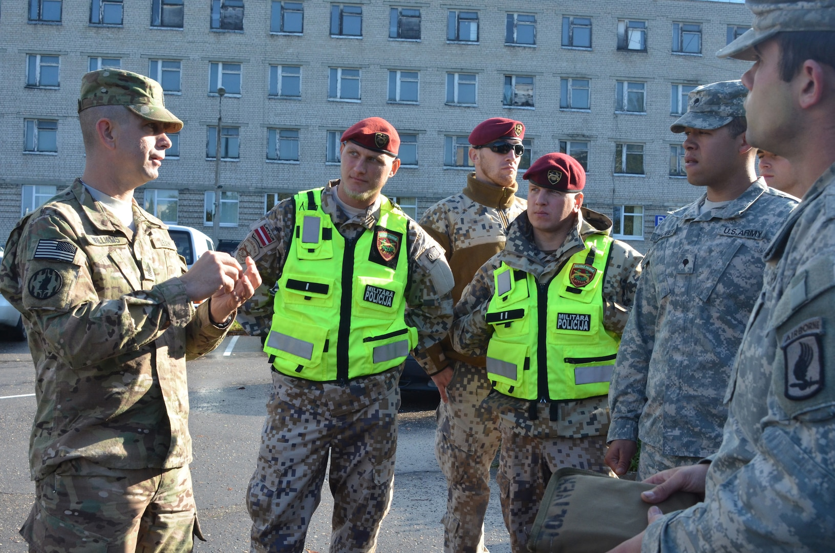 Michigan Army National Guard Sgt. Maj. Edward Williams, with the 210th Military Police Battalion, Taylor, Michigan, helps facilitate traffic accident investigation training along with his Latvian counterparts from the Latvian MP Company, Riga, Latvia, Sept. 23, 2014. The Michigan the Latvian MP's are training together in support of Operation Silver Arrow, in conjunction with United States Army Europe and Operation Northern Resolve.