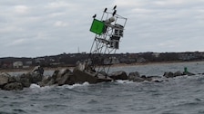 Aid to Navigation damaged from Superstorm Sandy barely sits atop the Block Island Jetty on Block Island, Rhode Island