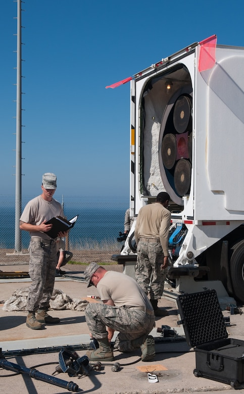 Missile maintenance Airmen prepare to unload a LGM-30G Minuteman III ICBM from a transport vehicle Aug. 26, 2014, at Vandenberg Air Force Base, Calif. A joint team from the 576th Test Squadron at Vandenberg AFB and the 91st Missile Squadron at Minot AFB, N.D., launched the missile Sept. 23, 2014, showcasing the capabilities of the Air Force's ground-based leg of the nation's nuclear triad. (U.S. Air Force courtesy photo)