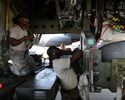 Senior Airman Breyana Anderson, left, and Staff Sgt. Raymond Edgerson, position an unarmed AGM-86B Air-Launched Cruise Missile for loading into the bomb bay of a B-52H Stratofortress Sept. 17, 2014, at Barksdale Air Force Base, La. The weapon was flown and released Sept. 22, as part of the Nuclear Weapons System Evaluation Program – an end-to-end operational evaluation of 8th Air Force and Task Force 204's ability to deliver an ALCM from storage to its final target. (U.S. Air Force photo/Senior Airman Benjamin Gonsier)