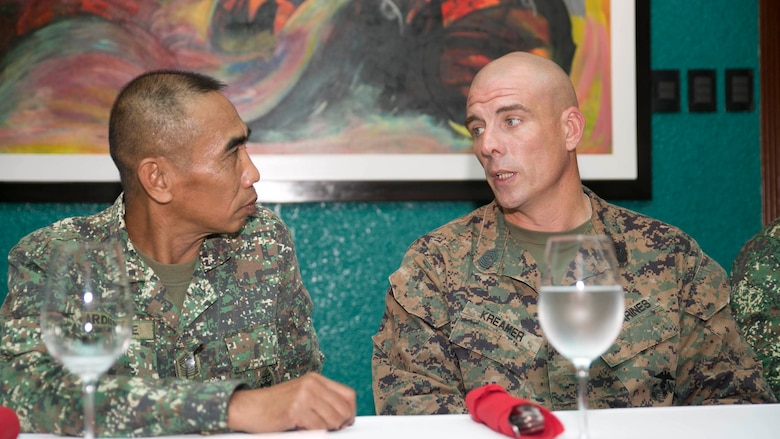 U.S. Marine Sgt. Maj. Howard Kreamer, right, talks with Philippine Marine Sgt. Maj. Jamie Ardiente in Puerto Princesa, Palawan Sept. 29 after the opening ceremony for Amphibious Landing Exercise 2015. PHIBLEX is an annual, bilateral training exercise conducted by the Armed Forces of the Philippines, U.S. Marines and Navy to strengthen interoperability across a range of capabilities, including disaster relief and contingency operations. Kreamer is the sergeant major of 3rd Marine Expeditionary Brigade, 3rd MEB, III Marine Expeditionary Force, and Ardiente is the 3rd Marine Brigade Sergeant Major, Armed Forces of the Philippines.