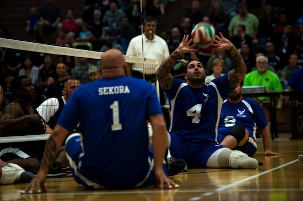 Air Force wounded warrior Stephen Malits hits a volleyball during a game of sitting volley ball against the Army wounded warrior team at the Olympic Training Center in Colorado Springs, Colorado, Sept. 28th, 2014. The 2014 Warrior Games features wounded athletes from throughout the Department of Defense who compete in Olympic style events for their respective military branch. The goal of the games is to help highlight the limitless potential of warriors through competitive sports.(U.S. Air Force photo by Airman 1st Class Scott Jackson)