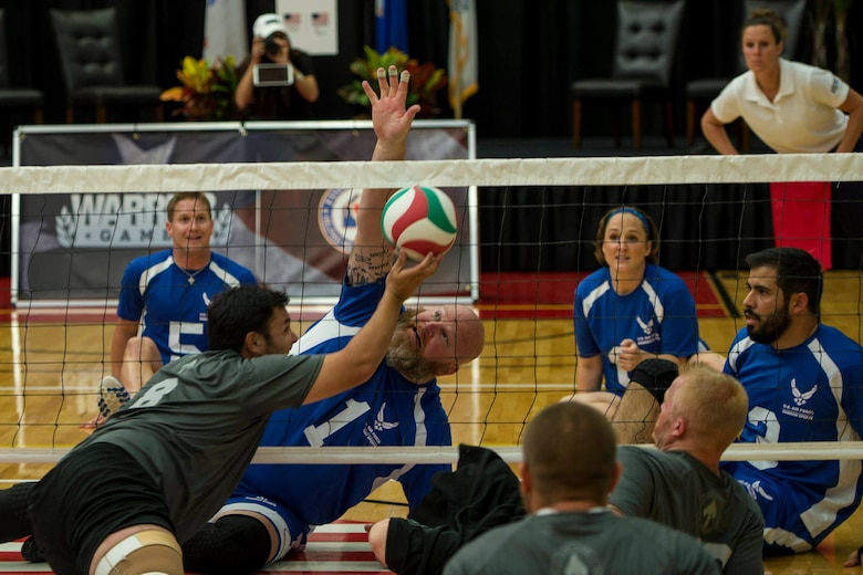 The U.S. Air Force team blocks a ball during a match of sitting volleyball at the opening day of the Wounded Warrior Games September 28, 2014 at the Olympic Training Center in Colorado Springs, Colorado. The 2014 Warrior Games features wounded athletes from throughout the Department of Defense who compete in Olympic style events for their respective military branch. The goal of the games is to help highlight the limitless potential of warriors through competitive sports. (U.S. Air Force photo by Airman 1st Class Taylor Queen)