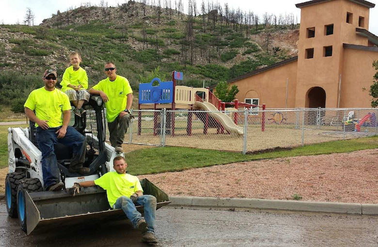 Contractor employees who volunteered for the project relax 