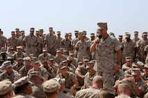 Col. Matthew Trollinger, commanding officer of the 11th Marine Expeditionary Unit, addresses Marines embarked aboard the USS Comstock during a visit, Sept. 27. The 11th MEU is deployed with the Makin Island ARG as a theater reserve and crisis response force throughout U.S. Central Command and the U.S. 5th Fleet area of responsibility. (U.S. Marine Corps photo by Sgt. Melissa Wenger/ Released)