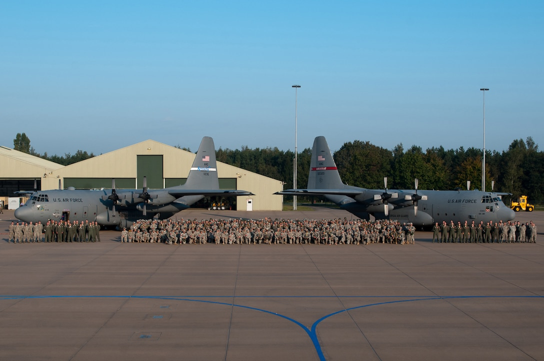 Aircrews from the Kentucky and Georgia Air National Guard pose with their C-130 aircraft and paratroopers assigned to the U.S. Army's 82nd Airborne Division, 173rd Airborne Brigade Combat Team and the 5th Quartermaster Company, as well as paratroopers from the Netherlands, Britain and Poland, at Eindhoven Air Base, Netherlands, Sept. 18, 2014. The Air Guardsmen flew the paratroopers as they completed a historic jump onto Tango Drop Zone in Groesbeek, Netherlands, to commemorate the World War II assault conducted by Allied forces 70 years ago during Operation Market Garden. (U.S. Army photo by Staff Sgt. Mary S. Katzenberger)