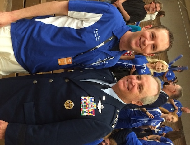 Air Force Chief of Staff General Mark A. Welsh III takes a photo with Special Agent Robert Davis, Det 212 commander, during opening ceremonies of the 2014 Warrior Games, Colorado Springs, Colo. SA Davis is a volunteer coach for Air Force athletes participating in this year's games.
