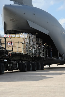 Airmen from the 502nd Logistics Readiness Squadron, Lackland JBSA, load medical supplies from the Air Force Medical Operations Agency onto a C-17 Globemaster III at Kelly Field Annex, Sept. 25, 2014. The C-17 was deployed from Altus AFB -- 97 Air Mobility Wing to support United States Africa Command and United Nations operations and efforts to fortify global health security infrastructure in the region and beyond. (U.S. Air Force photo by Senior Airman Krystal Jeffers)